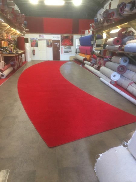 Curved red carpet for cinema opening
