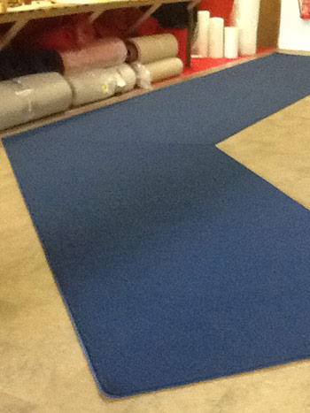 Carpet Edging of blue custom shape mat